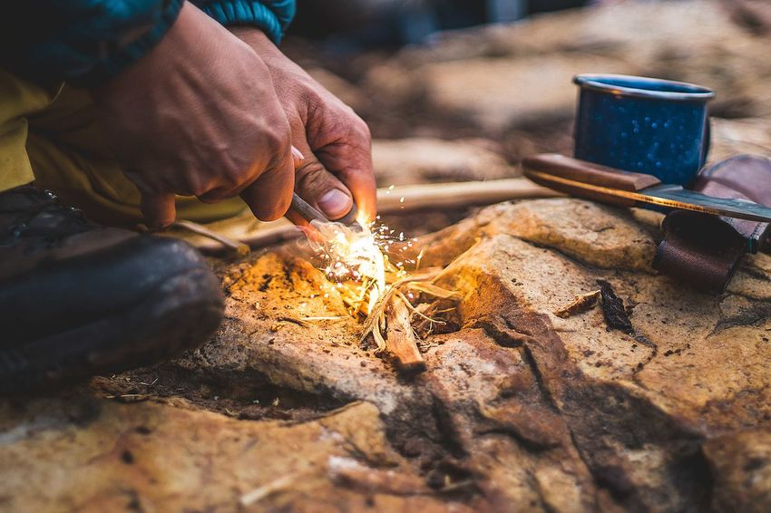 Adventures Light A Fire Batoning Wood Bushcraft Bushcraft Knife Campinglife Chop Wood Firebar Fireflint Firemaking Flintstone Hand Holding Human Body Part Human Hand Men Occupation One Person Outdoors Real People Rocks Selective Focus Sparks