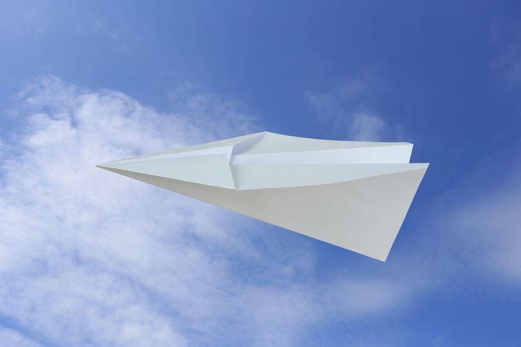 Low angle view of white flag against blue sky
