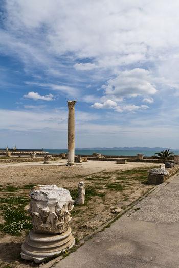 Old ruins at byrsa by mediterranean sea against cloudy sky