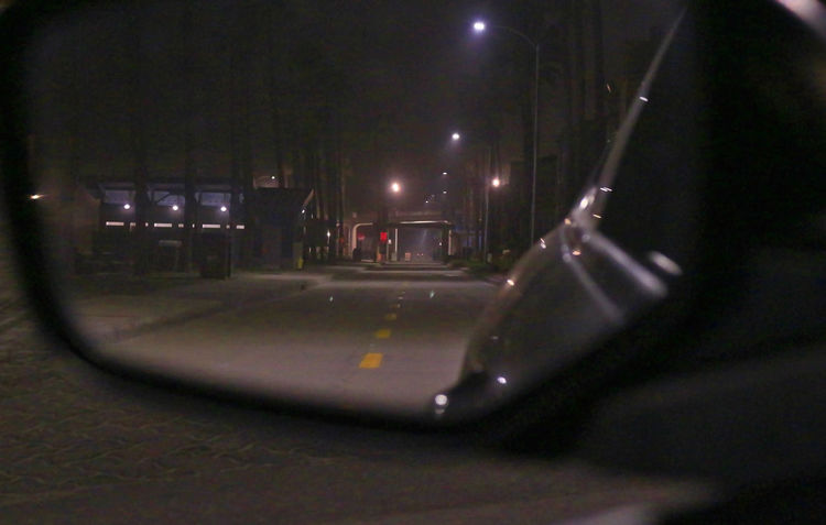 The View behind thru my car side mirror at night time at Oceanside Beach area Car Mirror City Life City Lights Look Into The Darkness  Night Night Lights Night Photography Painting With Light Palm Trees ❤❤ Photographs From Inside My Ride Street Light Street Photography Transportation View From Above Team Awesome's Late Night Adventures Depth Of Field
