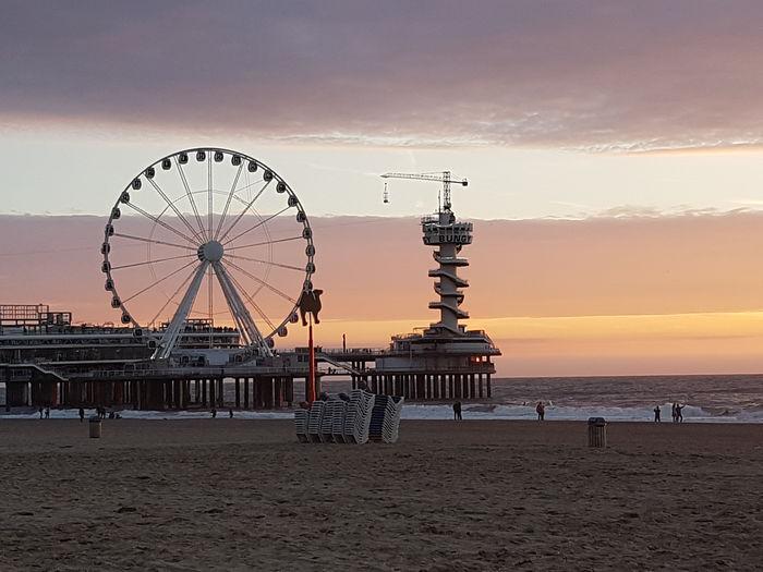 Ferris wheel at beach during sunset