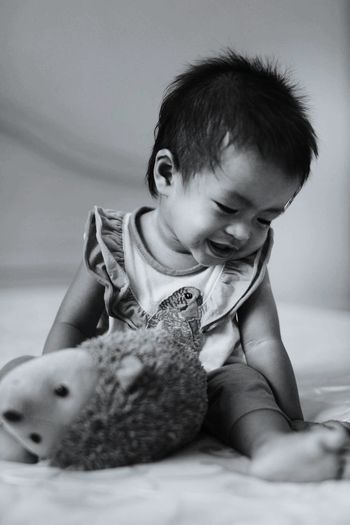 My Daughter Aira Wafa and her hedgehog toy Hedgehog Toys Malaysianbabies Child Childhood Smiling Happiness Cute Cheerful Females Baby Sitting Innocence First Eyeem Photo