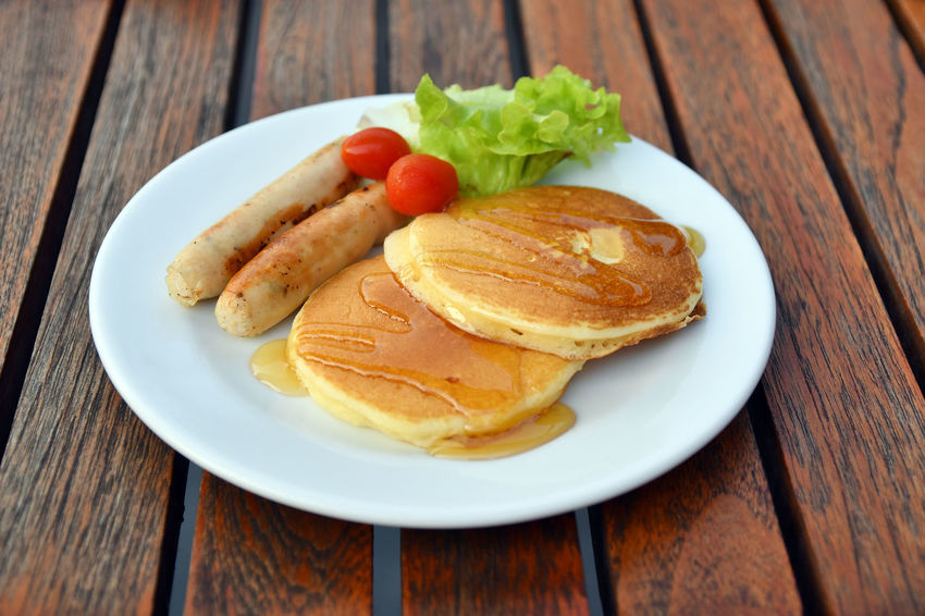 Pan cakes and sausages for breakfast Breakfast Sausages Close-up Day Food Food And Drink Freshness Healthy Eating Indoors  No People Pancake Plate Ready-to-eat Table Wood - Material