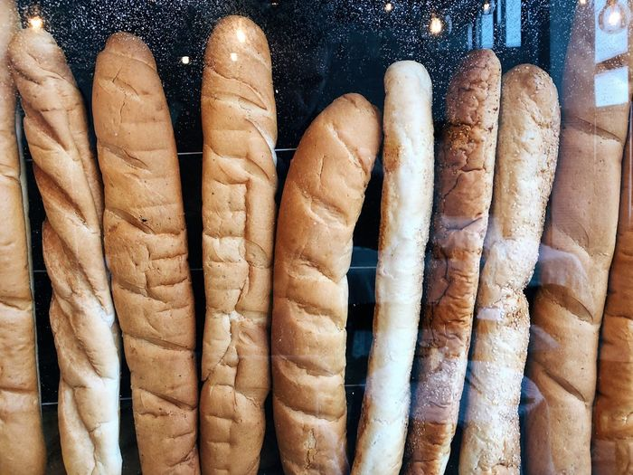 delicious bread at the shop window Baguette French Food Calories Shop Copy Space Sugar Bakery Bread Baked Close-up No People Full Frame Still Life Backgrounds Large Group Of Objects Day Side By Side In A Row Group Of Objects