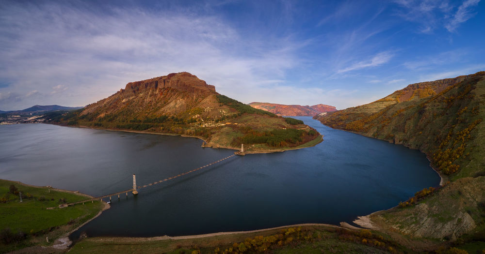 Over the dam Nature Drone  Landscape Aerial View Outdoors View Scenery Point Of View Scenics - Nature Water Sky Beauty In Nature Tranquil Scene Mountain Tranquility Cloud - Sky Day Non-urban Scene Idyllic Land Mountain Range Environment Travel Bridge Damaged