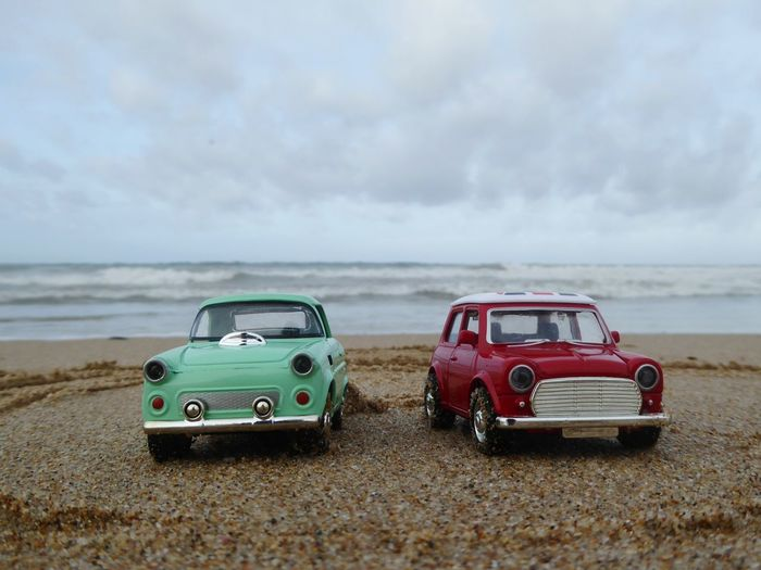 Toys cars Tanger  Morocco EyeEm Selects Mini London Car Peugeot Toys Route Playa #beach Car Beach Sand Cloud - Sky Landscape Sky Sea Summer Storm Tourism Nature Sun Transportation Marram Grass Dramatic Sky Red Sunny Desert Camping Water
