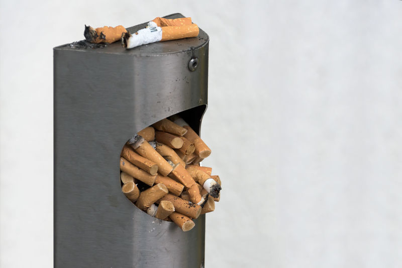 Ashtray  Cigarette Stubs Cigarettes Close-up Day No People Overflowing Urban