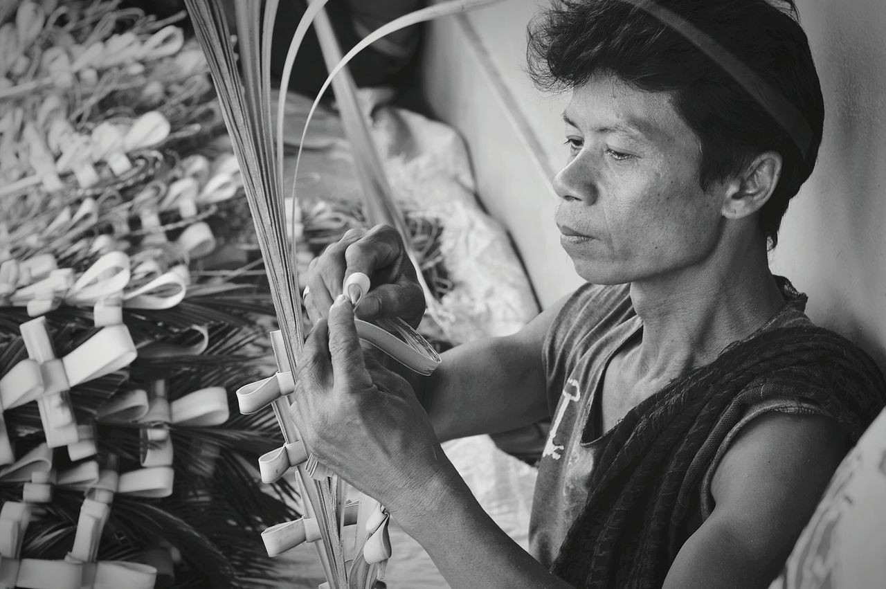 real people, one person, transportation, skill, bicycle, land vehicle, men, day, mechanic, workshop, outdoors, working, repair shop, young adult, close-up, people