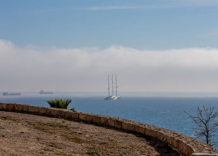 Water Sky Sea Scenics - Nature Tranquil Scene Nature Beauty In Nature Cloud - Sky Day Tranquility No People Horizon Over Water Horizon Architecture Built Structure Non-urban Scene Tower Land Beach Outdoors Guidance Colors Yatch Ship Mediterranean