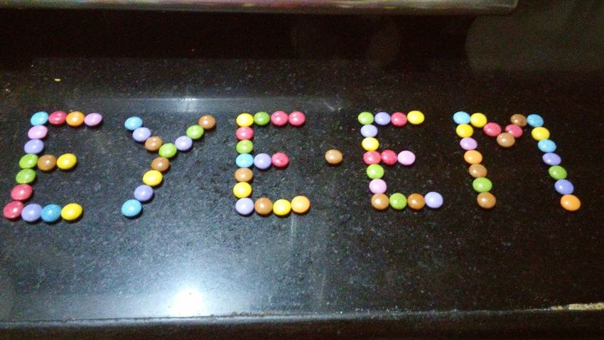 Multi Colored No People Close-up Outdoors Day Black Background EyeEm Arrangement Colourful Eating Colourful Chocolate Shape Bead Marbles Variation Name Design Letter Alphabets Name Art Name Plate