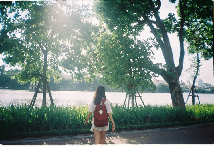 Sometimes we need to take a rest after long long hard- working Beauty In Nature Canonphotography Day Film Film Photography Filmcamera Filmisnotdead Filmphotography Fujic200 Girl Hanoi Hoan Kiem Lake Lakeview Lifestyles Nature Outdoors Sky Standing Sunshine Sunshine ☀ Tree Trees And Sky Vietnam Vietnamese Women