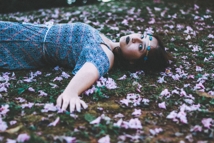 Day Flower Fragility Full Length Happiness Lifestyles Lying Down Nature One Person Outdoors People Real People Relaxation Young Adult Young Women