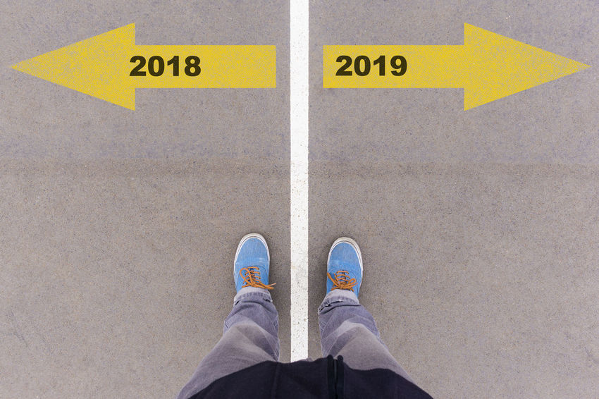 2019 Greeting Happy New New Year Silvester Arrow Symbol Beginning Change Direction High Angle View Human Body Part Human Leg Low Section One Person Personal Perspective Plans Standing Start Symbol Year Yellow