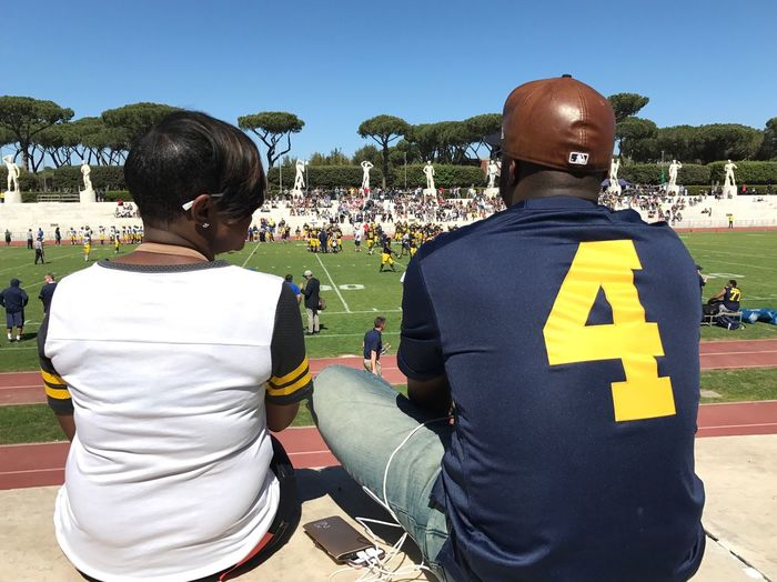 Go Blue Michigan American Football - Sport Number 4 Day At The Game Stadium Human Representation Statues Michigan State University Football Team Blue Sky Real People Rear View Day Leisure Activity Men Lifestyles Large Group Of People Outdoors Women Adult People Tree