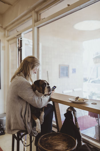 Woman with dog at home