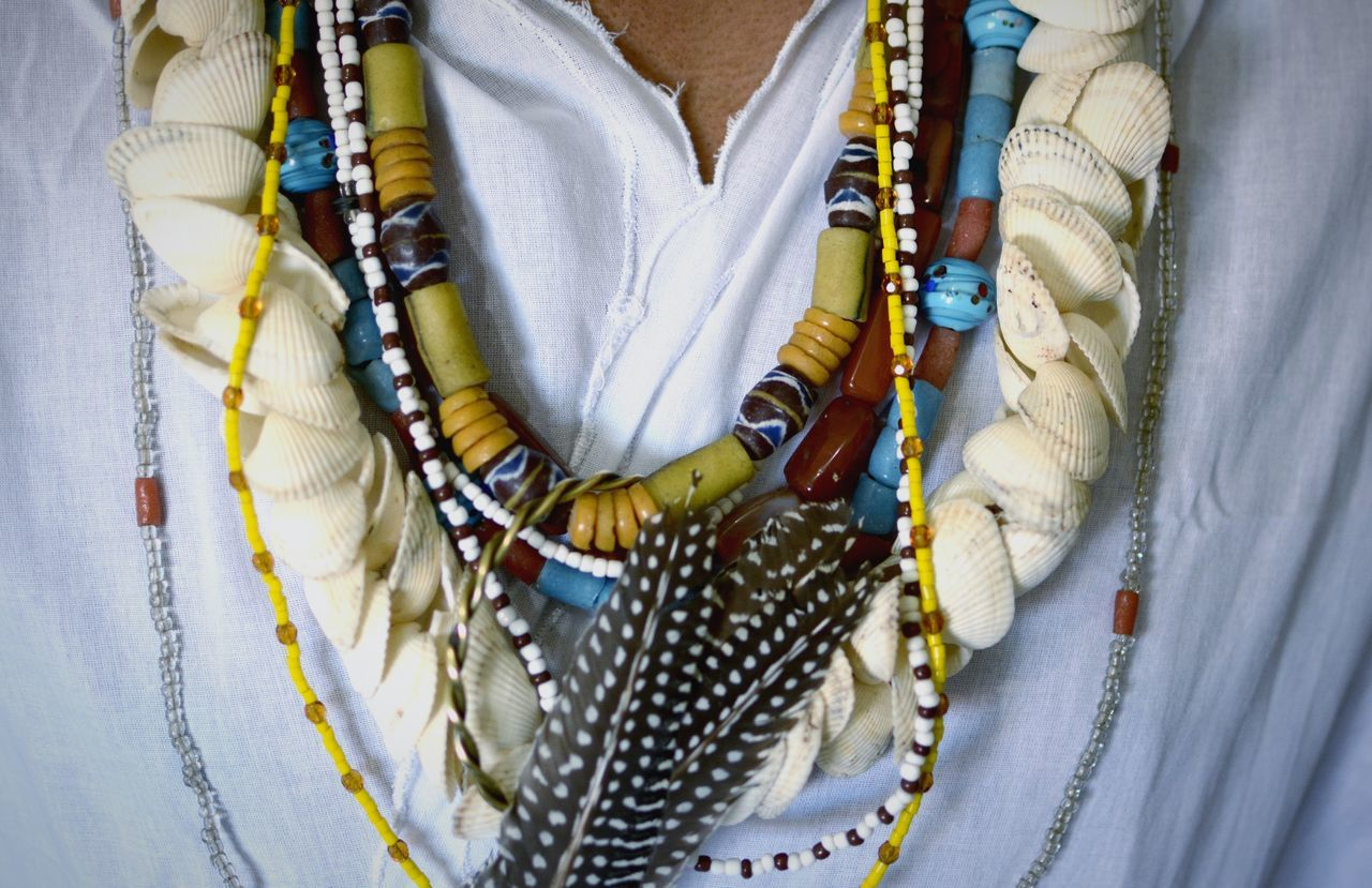 Close-up of traditional woman wearing bead necklaces