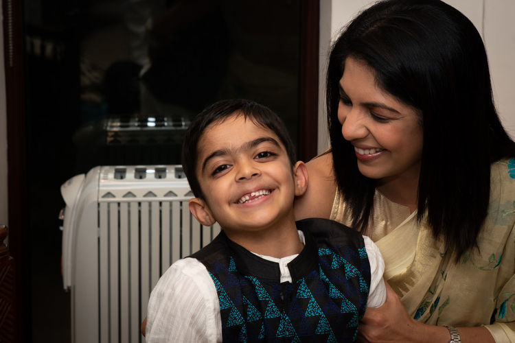 Smiling mother and son at home