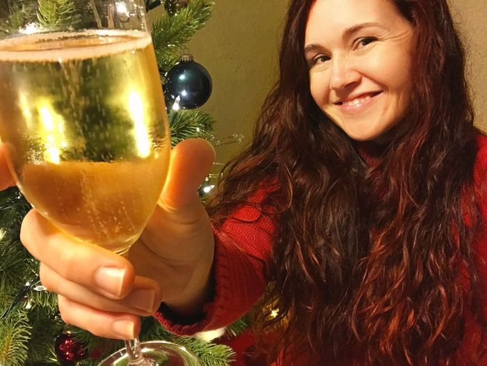 christmas tree Christmas Cheers Happiness Joy Happy Long Hair Brunette Celebrate Celebrating Holiday Alcoholic Drink Champagne New Years Eve Celebration Alcohol Drink Food And Drink Real People One Person Refreshment Celebration Drinking Glass Smiling Indoors  Adult