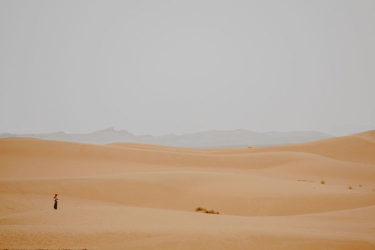 Man Standing On Desert Against Sky