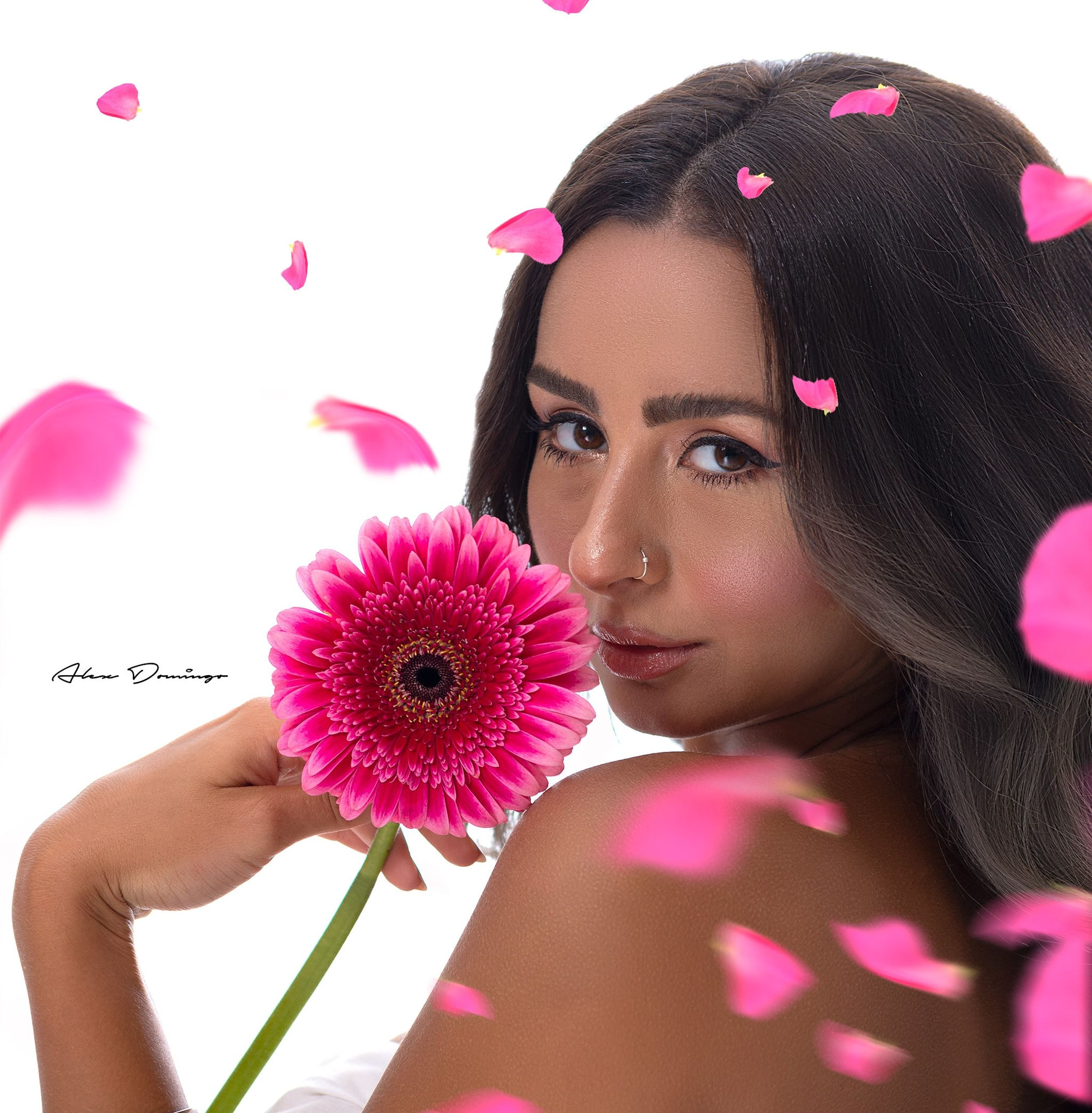 pink, flower, women, flowering plant, portrait, one person, purple, adult, young adult, plant, beauty in nature, make-up, headshot, fashion, hairstyle, looking at camera, female, nature, emotion, long hair, freshness, holding, eyelash, studio shot, human eye, petal, cute, smiling, indoors, brown hair, happiness, multi colored, close-up, lifestyles, human face, rose, clothing, child, positive emotion
