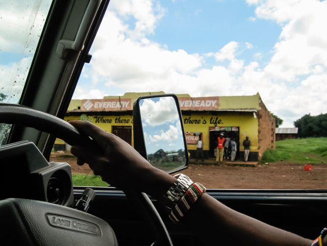 Land Cruiser Kenya Kenyan Africa African Beads Beaded Bracelet Watch Steering Wheel Hands On The Wheel Passing By Through The Window Street Scene Drive By Photography Eveready Side View Side View Mirror
