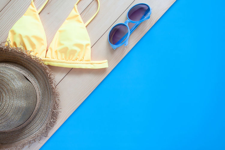 Flat lay summer concept Blue Indoors  Copy Space Hat No People Glasses Table Fashion Clothing Close-up High Angle View Publication Sunglasses Wood - Material Eyeglasses  Personal Accessory Directly Above Blue Background Vacation Vacation Time Holiday Sunset Summer Summertime Activity Travel Traveling Tourist Bikini Flat Lay Flatlay Top View Fashion Accessories Beauty