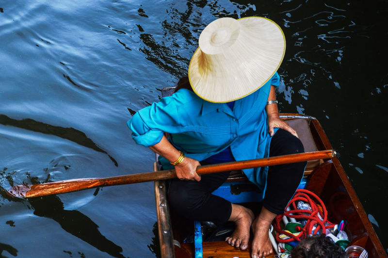 An old lady floating market in bangkok