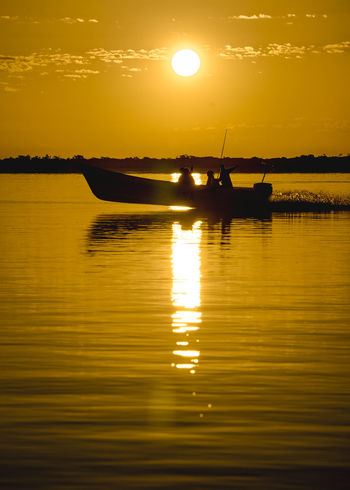 Paint The Town Yellow Beauty In Nature Lake Mode Of Transport Nature Nautical Vessel No People Orange Color Outdoors Reflection Scenics Silhouette Sky Sun Sunlight Sunset Tranquil Scene Tranquility Transportation Water Waterfront Yellow Lostplace Lost In The Landscape