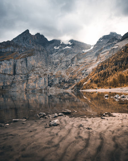 Autumn at it's best 🍂 Autumn Autumn colors The Week on EyeEm Beauty In Nature Cloud - Sky Day Environment Fall Lake Land Landscape Mountain Mountain Peak Mountain Range Nature No People Oeschinensee Orange Color Outdoors Reflection Rock Scenics - Nature Sky Water Wilderness