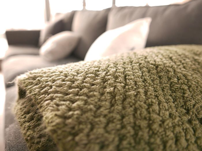 Close-up of throw blanket on sofa at home