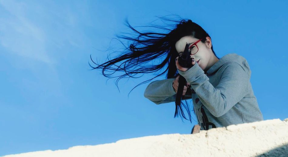 girl and gun AiRSOFTGUN airsoft,m16,macine gun, blue sky