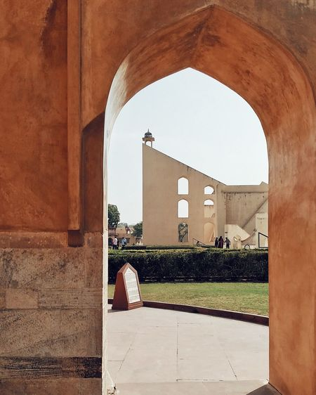 Buildings seen through arch entrance of building