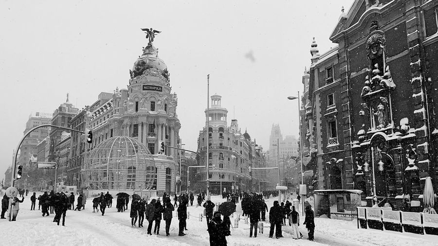 Group of people in front of building in winter