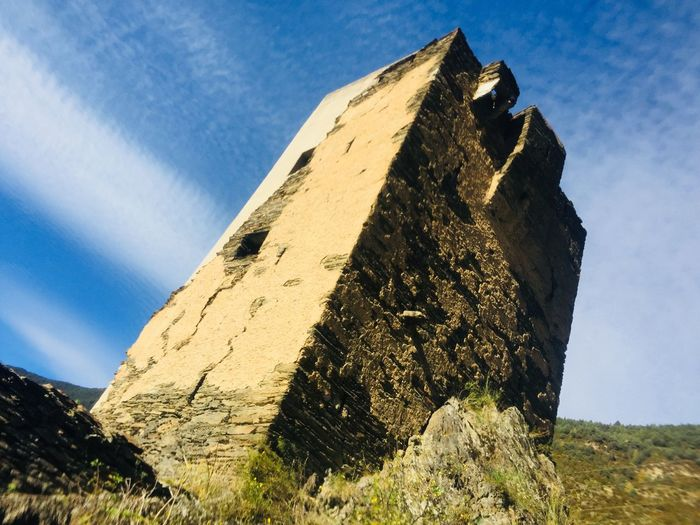 Front view of Torre del Moro, Medieval Tower Torre Del Moro Encamp Medieval Architecture Historical Monuments Medieval Tower Andorra Low Angle View Day History No People Ancient Architecture Ancient Civilization Building Exterior Close-up Nature Sunlight