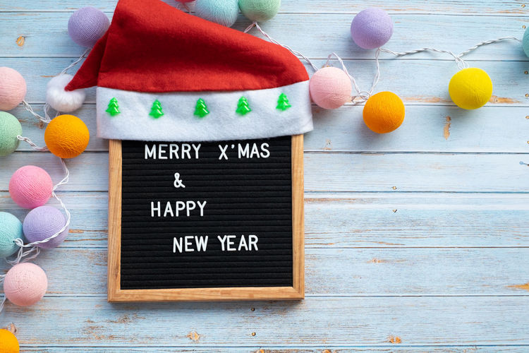 Text Food Communication Western Script Wood - Material Multi Colored Celebration Table No People Holiday Indoors  Message MerryChristmas New Year Happy Greeting Decoration Season  Festive Santa Hat Flat Lay High Angle View Top View Wooden Floor Copy Space