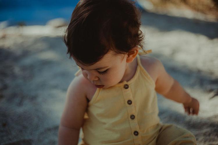 Cute girl playing at beach