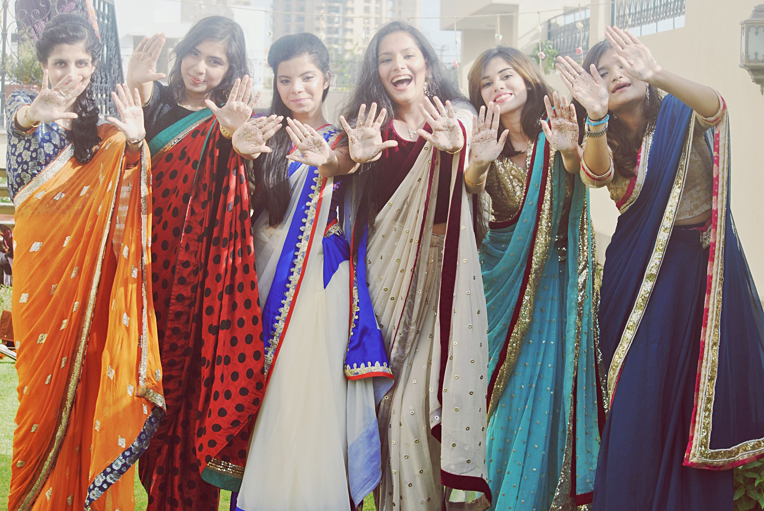 lifestyles, leisure activity, happiness, traditional clothing, large group of people, casual clothing, human representation, standing, togetherness, fun, enjoyment, front view, smiling, person, art, art and craft, cultures, young adult