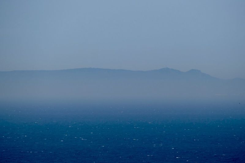 Spain as seen from Tangier Travel Destination Travel Photography Strait Of Gibraltar Ocean View Ocean Tranquil Scene Water Beauty In Nature Tranquility Scenics - Nature Sea Sky Mountain Copy Space No People Fog Waterfront Blue Idyllic Mountain Range My Best Travel Photo