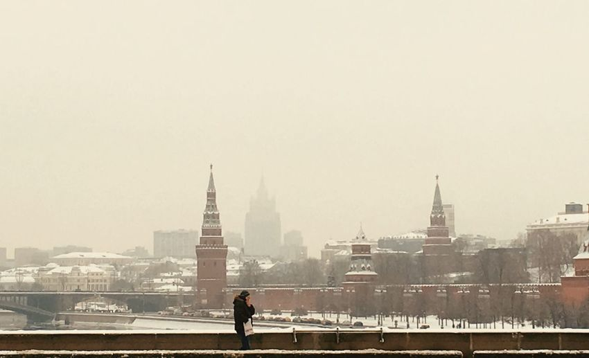 Smog One Men Only Bridge Shiluette Moscow Kremlin Moscow Architecture Built Structure Building Exterior City Sky Building Travel Destinations Outdoors One Person Cityscape Tourism