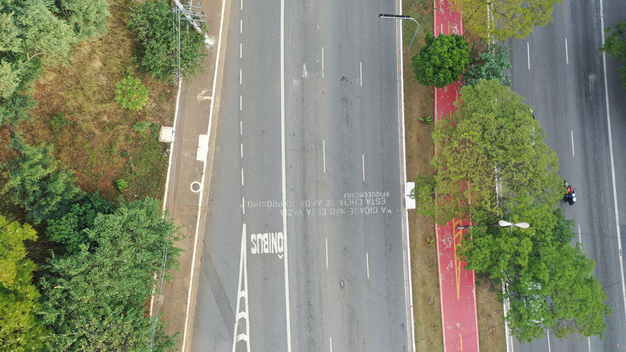 High angle view of text on road by trees