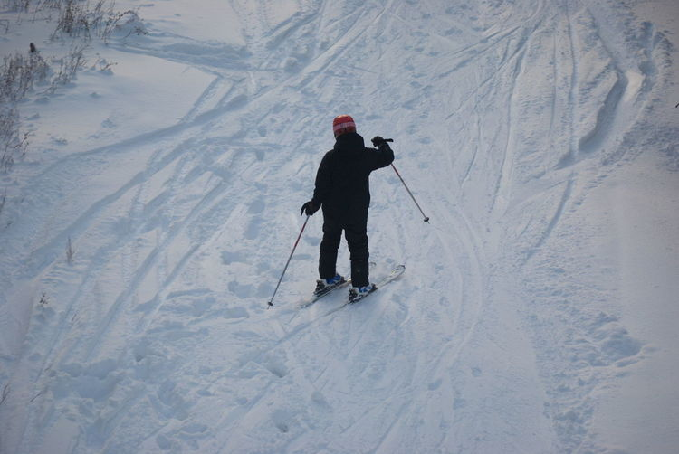 Full length of man skiing on snowy mountain
