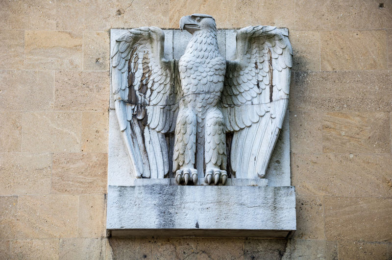 Eagle sculpture on wall