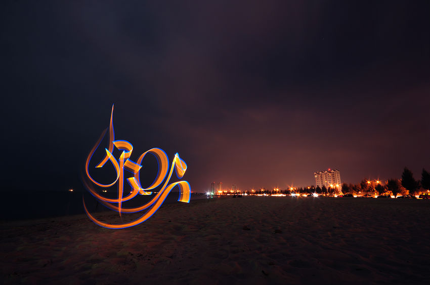 Arabic Calligraphy Light Graffiti of Ramadhan. Arabic Calligraphy Beach Bulb Mode Calligraffiti Calligraphy City Electricity  Illuminated Landscape LED Light Light Graffiti Lighting Equipment Motion Neon Night Outdoors Ramadhan Slow Shutter
