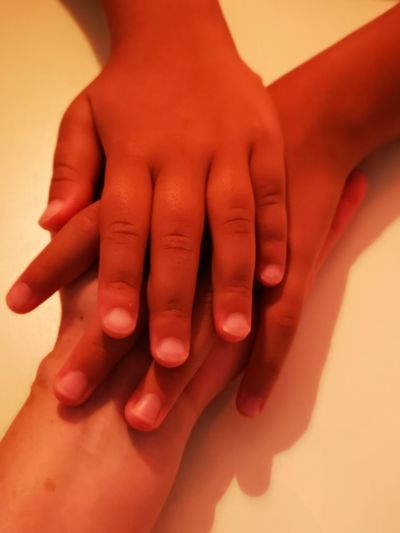 Close-up of hands touching baby