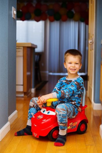 Toddler boy on plastic toy car Lightning Mcqueen On Top Sitting Childhood Child Full Length One Person Indoors  Males  Sitting Innocence Toy Baby Cute Toddler  Happiness Lifestyles Young Flooring Real People Boys Portrait