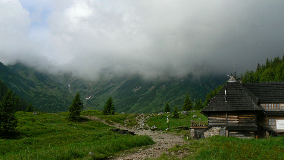 Mountain shelter Hiking Low Clouds Tatra Mountains Tatry Architecture Beauty In Nature Built Structure Day Grass Hiking Trail Landscape Mountain Mountain Range Mountain Shelter Nature No People Outdoors Scenics Sky Tranquil Scene Tranquility Tree
