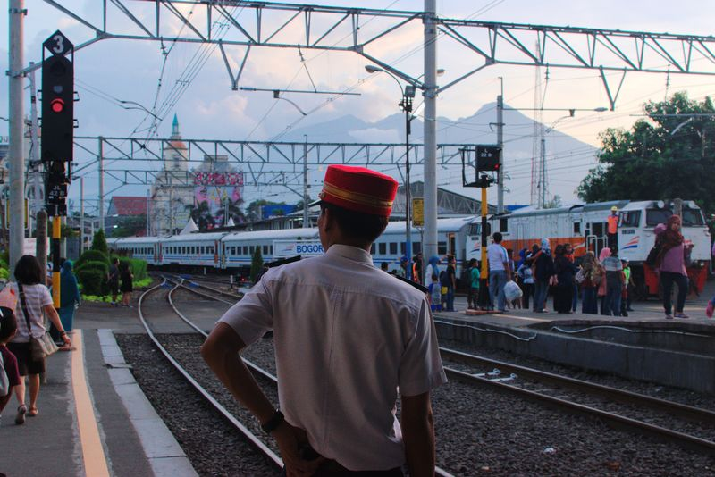 Bogor, Dec 2017 Streetphotography Documentaryphotography Commuting Train Station Train Commuter Commute Candid UNPOSED Street Railroad Track Rear View Rail Transportation Railroad Station Platform Only Men Transportation Men Built Structure Real People Outdoors City Architecture Large Group Of People People The Street Photographer - 2018 EyeEm Awards