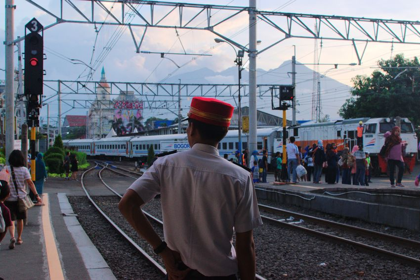 Bogor, Dec 2017 Streetphotography Documentaryphotography Commuting Train Station Train Commuter Commute Candid UNPOSED Street Railroad Track Rear View Rail Transportation Railroad Station Platform Only Men Transportation Men Built Structure Real People Outdoors City Architecture Large Group Of People People