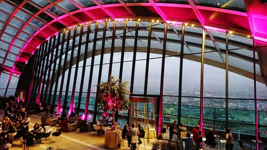 Architecture Indoors  Travel Destinations Modern People Large Group Of People City Adult Dusk Skygarden Pink
