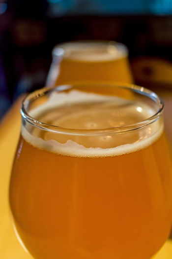 Close-up of beer in wineglasses on table